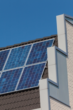 Side view of a newly build house with solar panels on the roof Stock Photo - 15139990