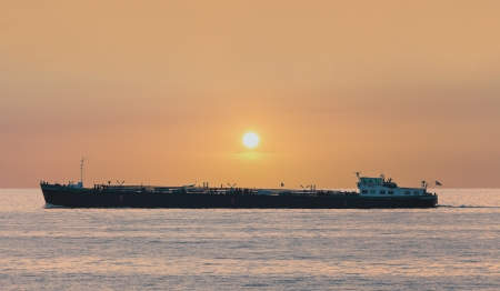 markermeer: Freight ship passing The Markermeer lake in Holland during sunset