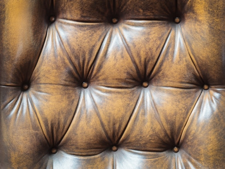 Detail of an old vintage brown couch with buttons Stock Photo