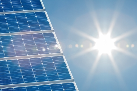 Blue solar panel with a bright sun shining on the right side Stock Photo - 15139971
