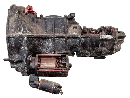 Vintage black car gearbox isolated on white with partly opened body photo