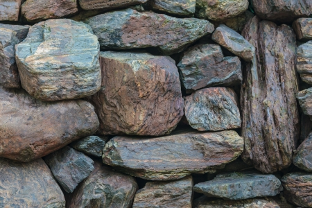 granite wall: Background of an old granite stone wall pattern