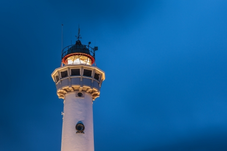 Lighthouse at the Dutch coast in Egmond aan Zee during night time
