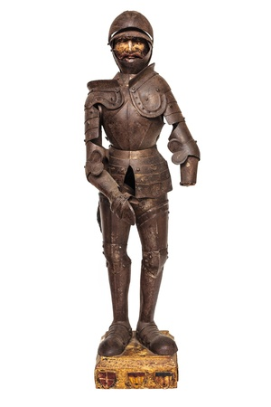 historical periods: Antique medieval wooden knight figurine with armor suit from the nineteenth century isolated on white Stock Photo