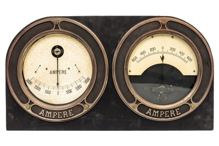 Old early twentieth century double ampere meter in wooden casing isolated on white