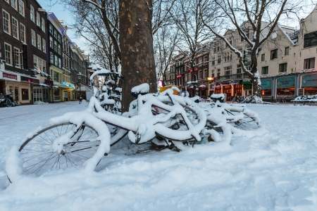 Bicycles covered with snow on the Thorbeckeplein town square in Amsterdam