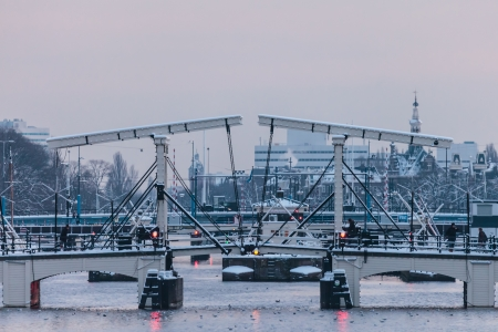 The famous canal bridge Magere brug during wintertime in Amsterdam photo