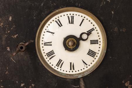 winder: Vintage 19th century clock in a rusty old steel casing