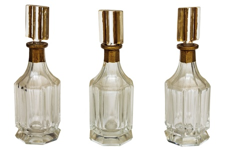 Three vintage art deco bottles isolated on a white background photo