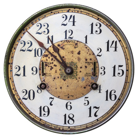 round face: Highly decorated early twentieth century clockface isolated on a white background