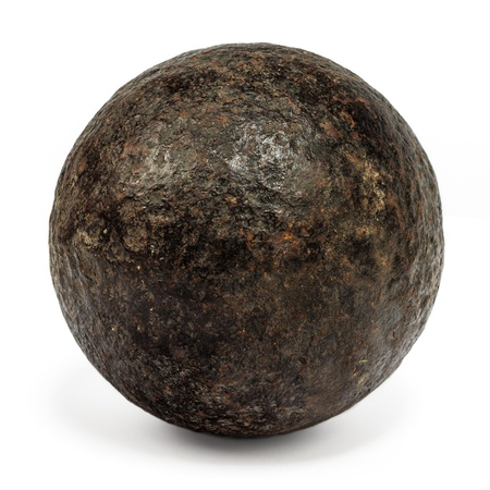 Genuine 18th century cannonball isolated on a white background