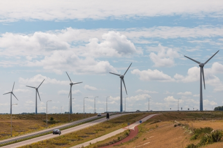 Row of windturbines in The Netherlands with a highway in front Stock Photo - 16294289