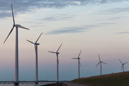 windfarm: Windturbine park in the Dutch Markermeer lake during sunset Stock Photo