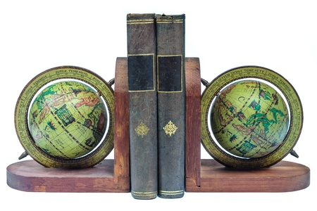 Globe bookends with ancient books isolated on a white background photo