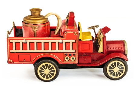 Vintage tin fire truck toy isolated on a white background photo