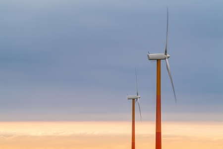 Two red and orange wind turbines during sunset Stock Photo - 16482855