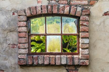 Ancient Dutch farm window with broken glass