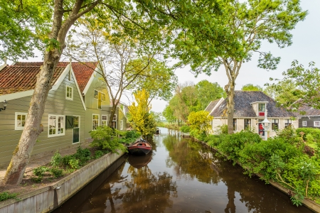 Summer view at a canal in the Dutch historic village Broek in Waterland