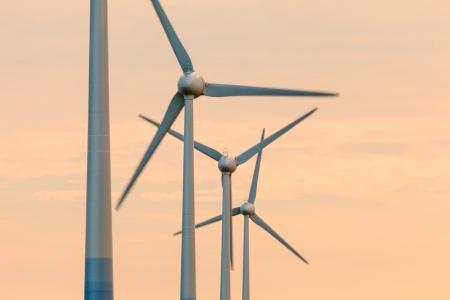 Row of wind turbines during an orange summer sunset Stock Photo - 16752368