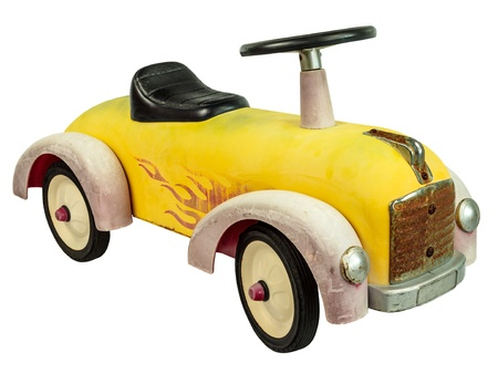Vintage yellow push car toy isolated on a white background photo