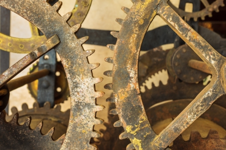 Set of vintage rusted gearwheels of an old church clock photo