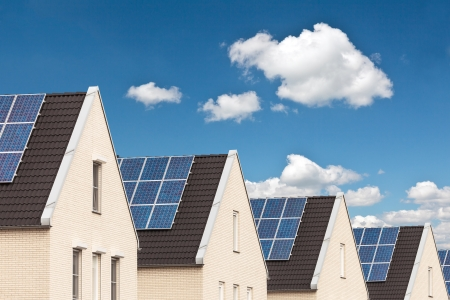 Row of Dutch new houses with solar panels attached on the roofs Stock Photo