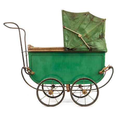Nineteenth Century baby pram isolated on a white background photo