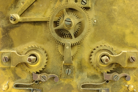 Antique gearwheels inside an old clock photo