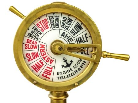 ancient ships: Vintage nineteenth century engine room telegraph isolated on a white background Stock Photo