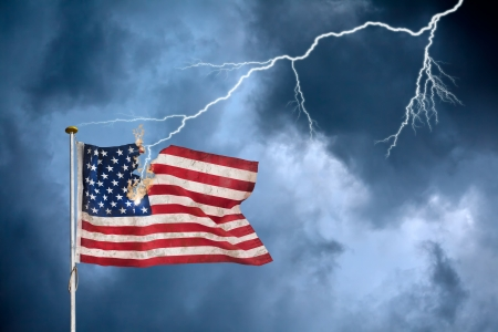 Concept of the economic crisis with the American flag struck by lightning