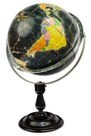 Antique black globe with focus on South America isolated on a white background photo