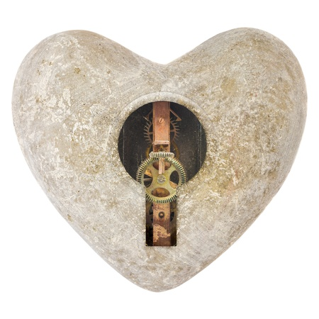 Stone heart shape with a keyhole with gearwheels inside isolated on a white background photo