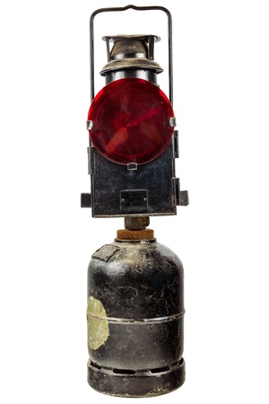 Old red traffic warning light running on gas isolated on a white background photo