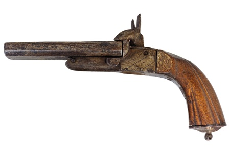 Nineteenth century handgun with wooden handle isolated on a white background photo