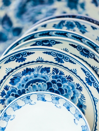 Ancient Dutch porcelain blue and white dishware from Delft photo