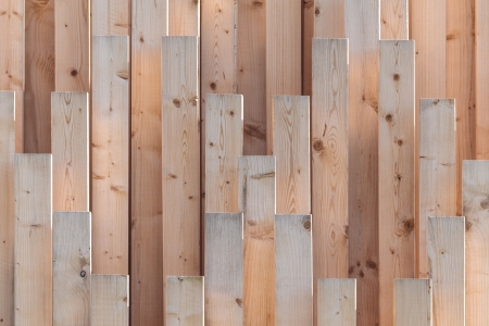 Vertical row of new wooden girders with different lenghts photo