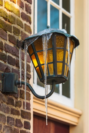 Antique Dutch lantern covered with icicles in winter photo