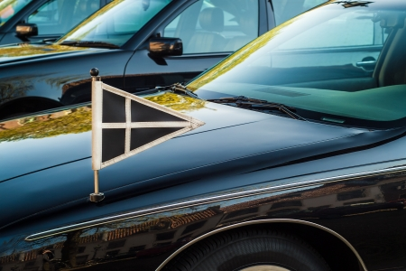 mourn: Official flag on a black Dutch funeral car