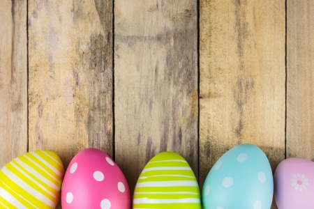 easter decorations: Dyed colorful easter eggs on a vintage wooden background