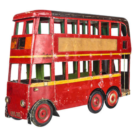 Vintage red English London bus toy isolated on a white background photo