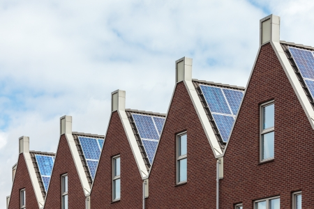 solar panel roof: Row of Dutch new houses with solar panels Stock Photo
