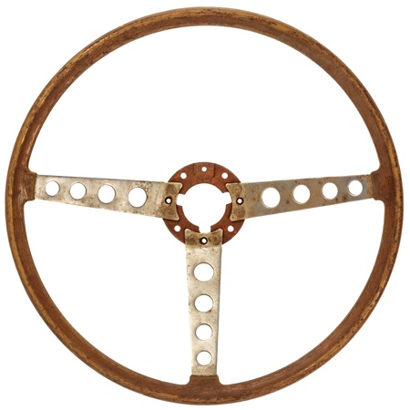 Antique wooden classic car steering wheel isolated on a white background photo