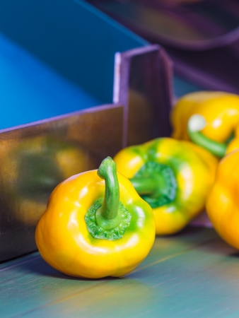 Group of fresh yellow bell peppers on a conveyor belt photo