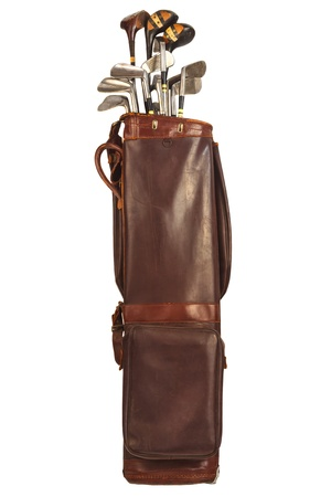 Antique brown leather bag with steel and wooden golf clubs isolated on a white background photo