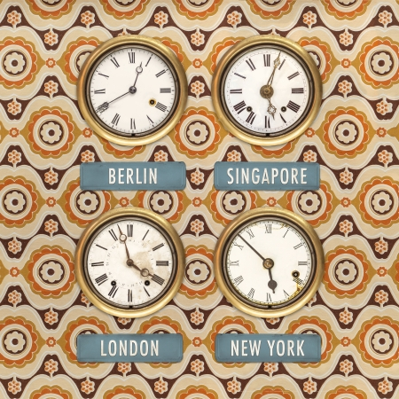 timezone: Retro styled image of old clocks with world times against a retro wallpaper