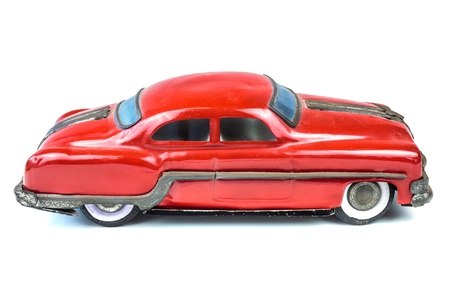 Fifties vintage red American car toy isolated on a white background