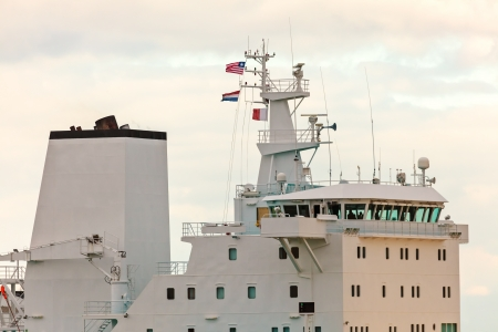 wheelhouse: Wheelhouse deck of a white modern industrial ship during sunset Stock Photo