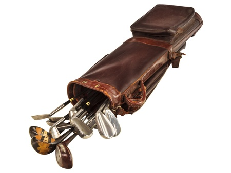 Antique brown leather bag with steel and wooden golf clubs isolated on a white background Stock Photo
