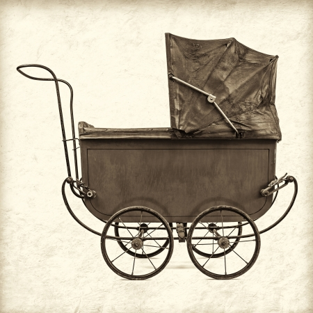 baby carriage: Retro styled sepia image of a vintage baby stroller Stock Photo