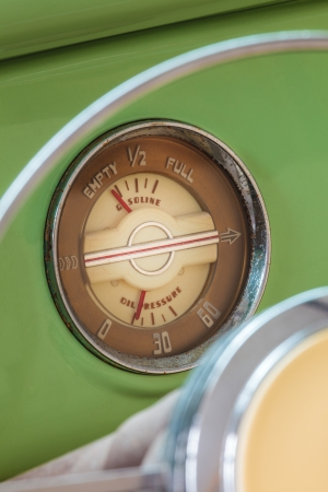 Detail of the dashboard of a classic mint green fourties car photo